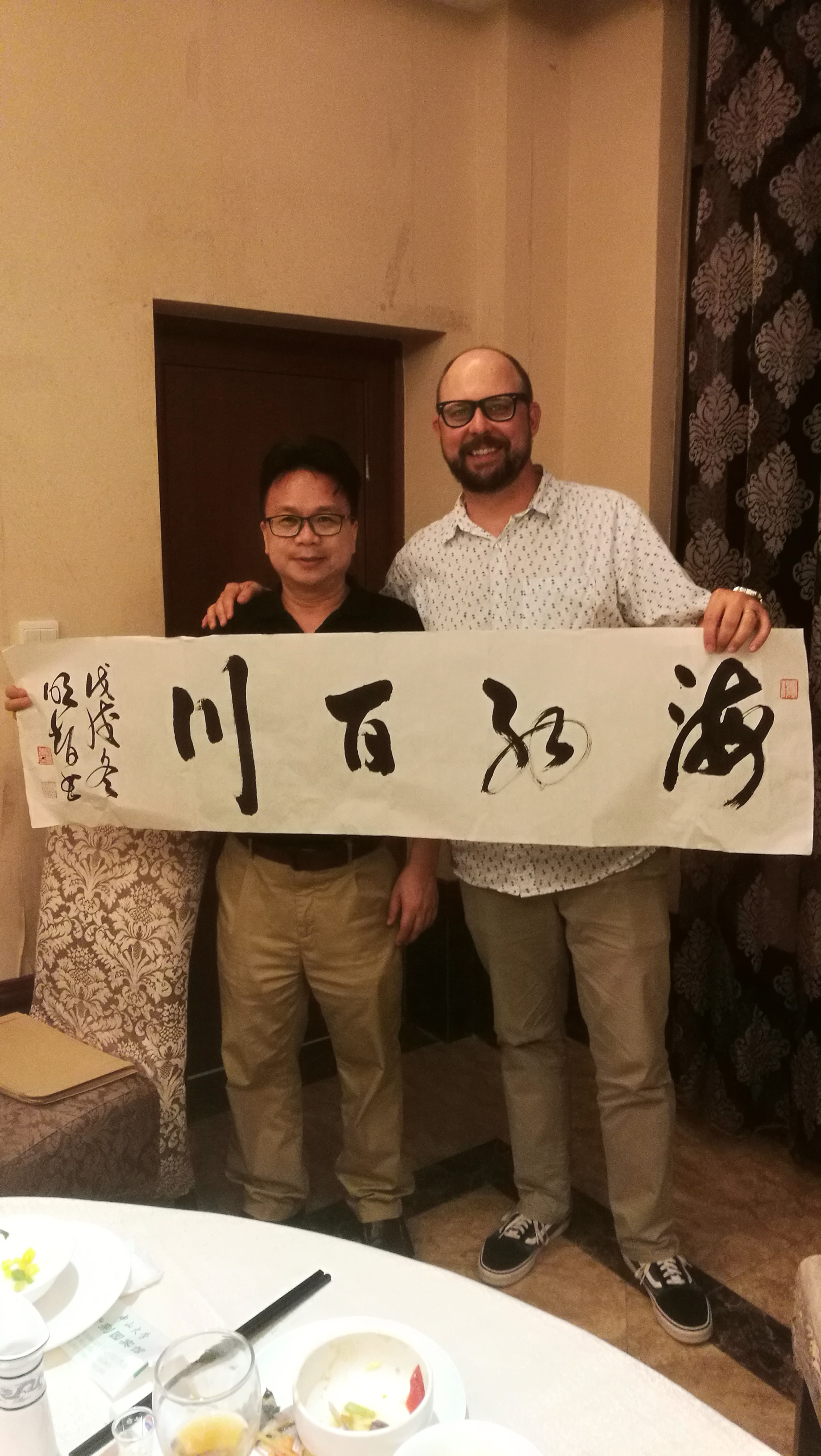 Foxfire Executive Director T.J. Smith (right) took part in an international conference on folklore preservation in China recently.