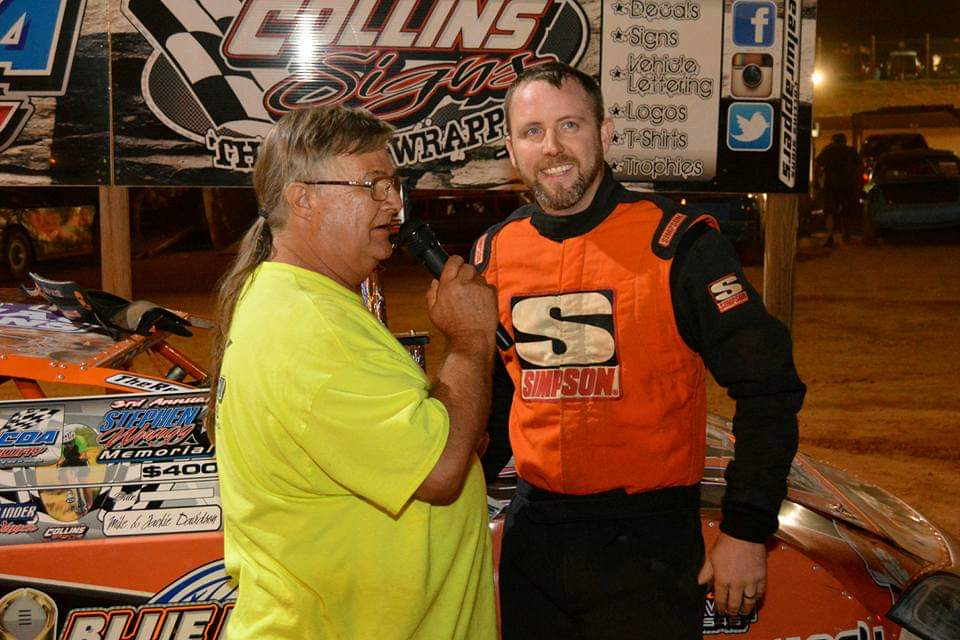 Jule Coffee interviews winning driver Harley Holden at the Toccoa Raceway after a race.  Coffee has been interviewing drivers in Toccoa Raceway's victory lane for about 15 years. (Submitted photo)