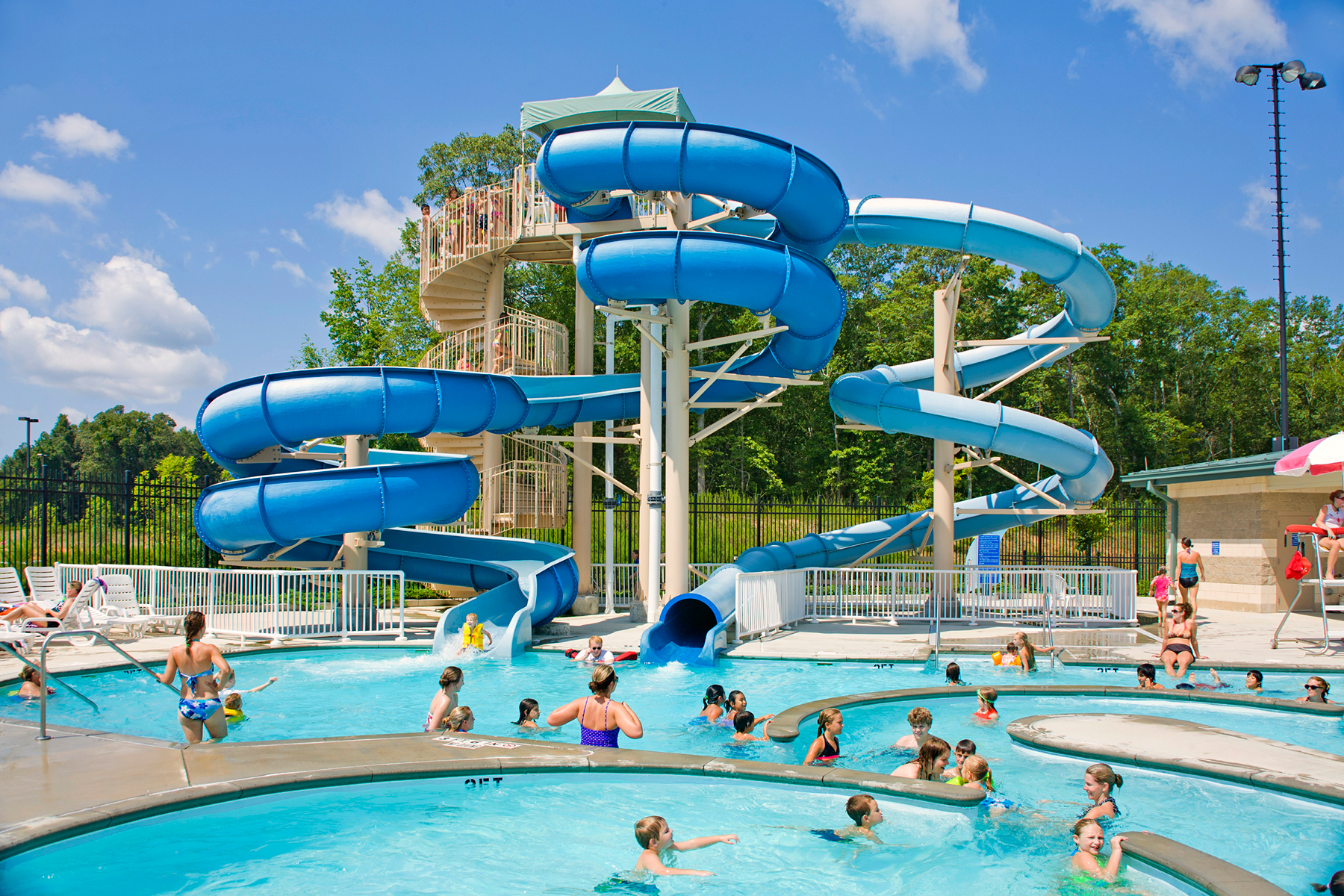 The Frances Meadows Aquatic Center boasts two three-story tall body slides.