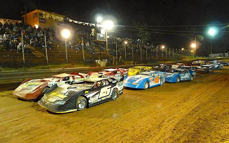 Cars running two across roar down the straightaway during a feature race at Toccoa Raceway.Photo racingin.com