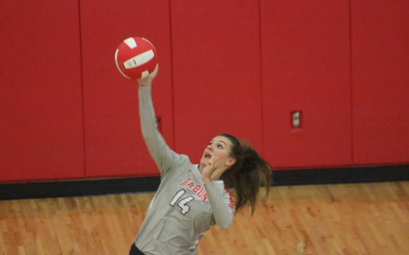 Rabun County's Gracie Deetz serves against Lumpkin County at Ken Byrd Court on Tuesday night.