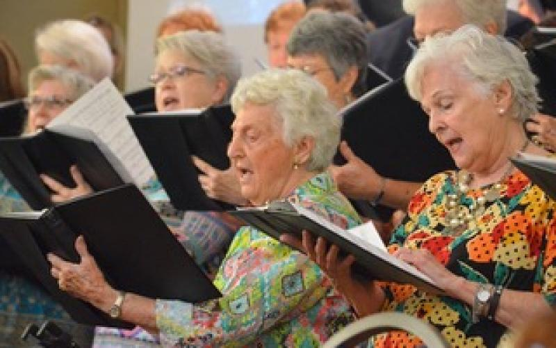Wayne Knuckles/The Clayton Tribune. Kathleen Arbitter and Linda Brandsma join the rest of the choir in song as Clayton Baptist Church celebrated their 200th anniversary Sunday.