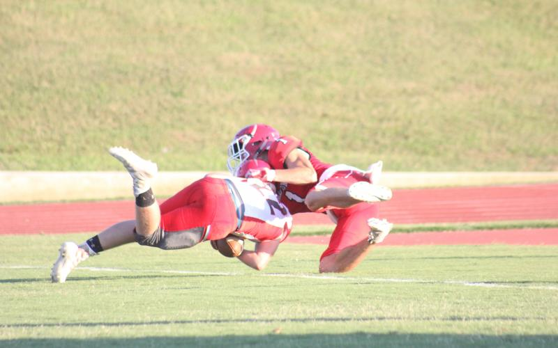 Rabun County's Dawson Lathan (1) tackles a Franklin (N.C.) player in the end zone during the first quarter of a preseason game at Frank Snyder Memorial Stadium in Tiger last Friday night. The play resulted in a safety. (Glendon Poe/The Clayton Tribune)