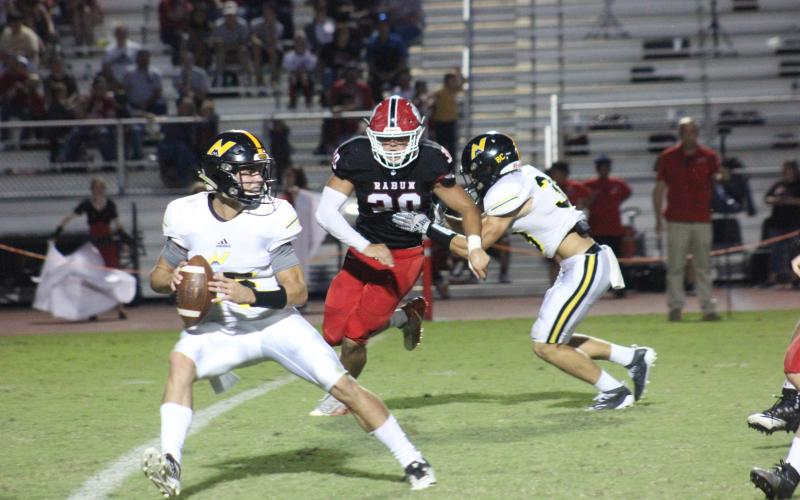 Rabun County linebacker Hoffman Windham (30) pursues North Murray quarterback Ladd McConkey during the first half at Frank Snyder Memorial Stadium in Tiger on Aug. 30. (Glendon Poe/The Clayton Tribune)