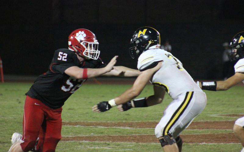 Rabun County defensive lineman Phillip Roberson, left, works around a North Murray offensive lineman during the second half at Frank Snyder Memorial Stadium in Tiger last Friday night. (Glendon Poe/The Clayton Tribune)