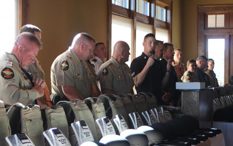 Chris Brown, vice president of SHIELD616, presents new protective gear to the Rabun County Sheriff's Office at The Waterfall Club on Aug. 29