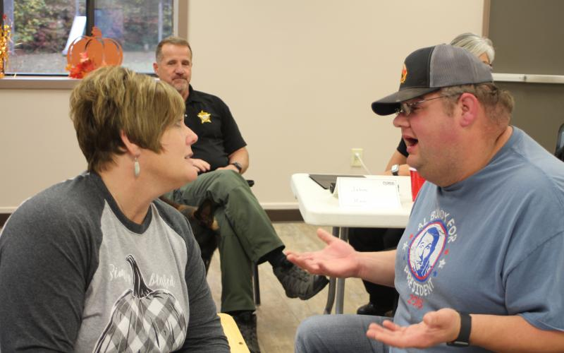 Lt. Misty Houston, Rabun County Emergency Medical Services, and Deputy Andy Beck help sort out people's problems by walking through an example narrative of a peer in a crisis situation during a scenario-based workshop at Peer Support training held at Tabernacle Baptist Church last Monday.