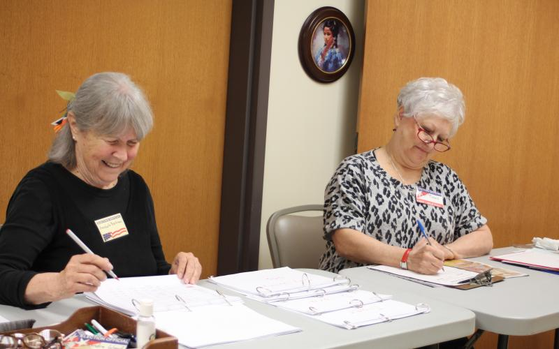Annabelle Barkman, left, and Jan Timms check people in and verify voter registrations for residents who participate in early voting at the Rabun County Board of Elections Office on Monday. Early voting ends Friday, Nov. 1.