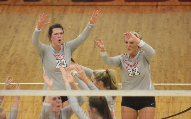 Rabun County's Destiny Deetz (23), Lexi Crump (22) and teammates celebrate a point against Armuchee during the first round of the GHSA Class A/AA-Public state playoffs in Tiger last Saturday. (Glendon Poe/The Clayton Tribune)