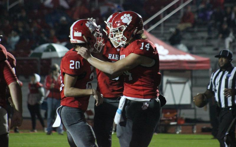 Rabun County wide receiver Sutton Jones (20) is congratulated by quarterback Gunner Stockton (14) and other teammates after making a touchdown catch during the first half against Social Circle at Frank Snyder Memorial Stadium in Tiger last Friday night. (Glendon Poe/The Clayton Tribune)