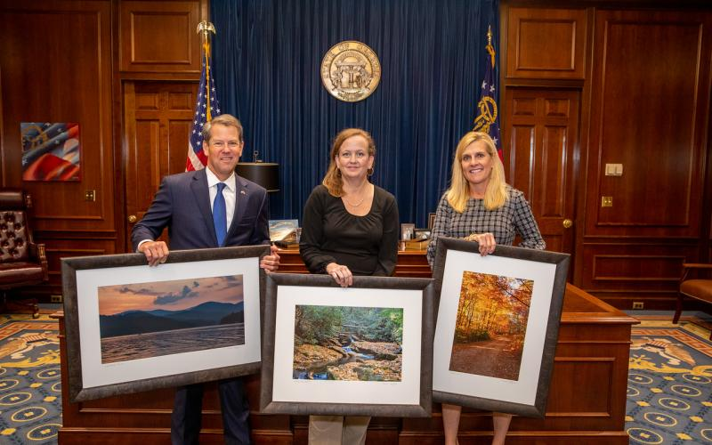 Rabun County photographer Michele Crawford, center, with Gov. and Mrs. Brian Kemp.