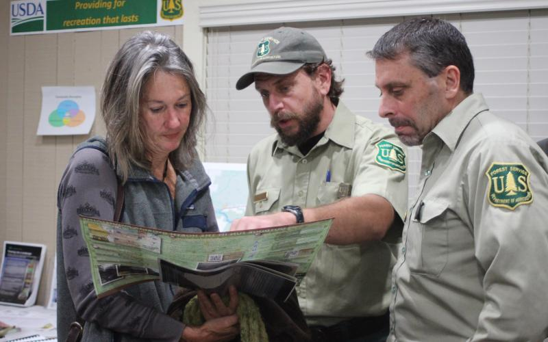 Megan Broome/The Clayton Tribune. Terri Jagger Blincoe, left, discusses the United States Forest Service Foothills Landscape Project with Phillip Waldrop, United States Forest Service, and Derek Fusco, Chattahoochee-Oconee National Forests.