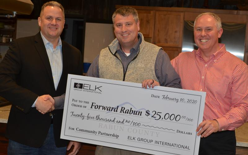 Wayne Knuckles/The Clayton Tribune Todd Webb, left, COO of Elk International, presents a check for $25,000 to Development Authority of Rabun County Board Chairman Claude Dillard (center) and Forward Rabun Director Rick Story at a recent meeting.