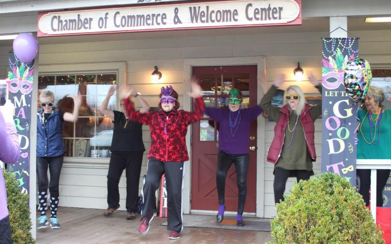 File photo Revelers take part in last year's Mardi Gras event at the Welcome Center.
