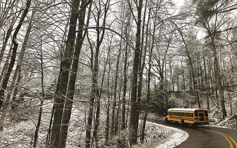 Daniela Cintron/The Clayton Tribune. A Rabun County school bus ferries students home following the early dismissal.