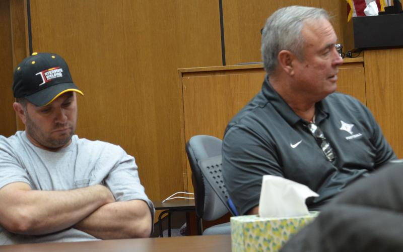 Wayne Knuckles/The Clayton Tribune County commissioners Will Nichols, left, and Kent Woerner at Friday's emergency meeting of the Rabun County Board of Commissioners.