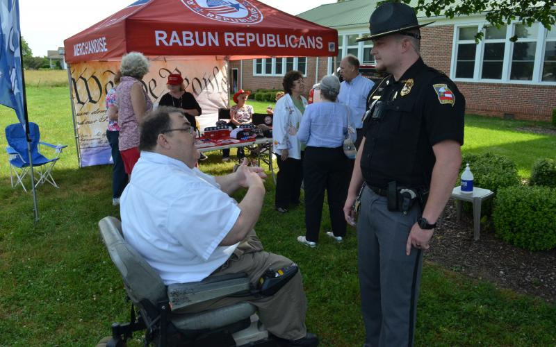 Wayne Knuckles/The Clayton Tribune. Ed Henderson, left, secretary of the Rabun County Republican Party, talks with Dillard Police Chief Jeremy Parker Saturday morning.