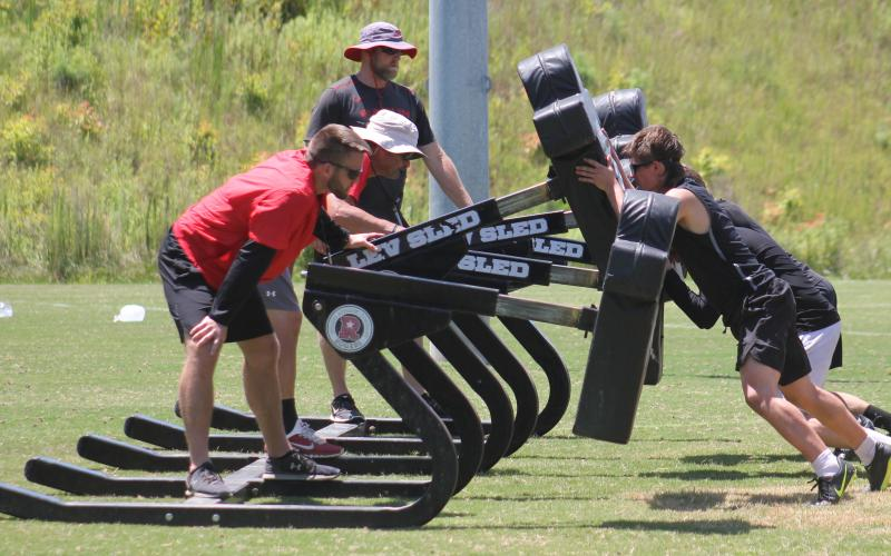 Andy Diffenderfer/The Clayton Tribune. Football workouts at Rabun County High have been divided into two groups, one starting in the morning and the other later in the day.