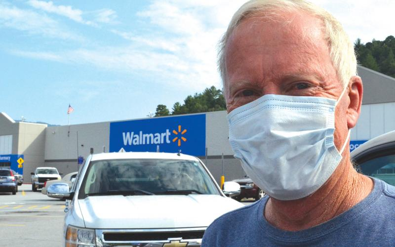 "Wayne Knuckles/The Clayton Tribune. ""I always wear a mask,"" said Keith Knudson as he prepared to shop at the Clayton Walmart Tuesday."