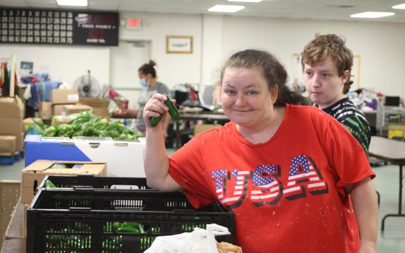 Megan Broome/The Clayton Tribune. Patricia Simonds browses food tables at the American Legion Post 220 food distribution last Thursday.