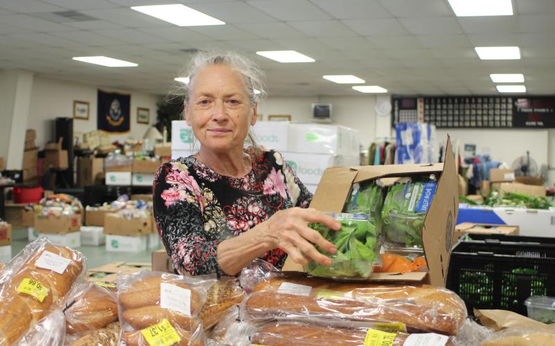 Megan Broome/The Clayton Tribune. Ursula Vicari browses food tables at the American Legion Post 220 food distribution last Thursday.