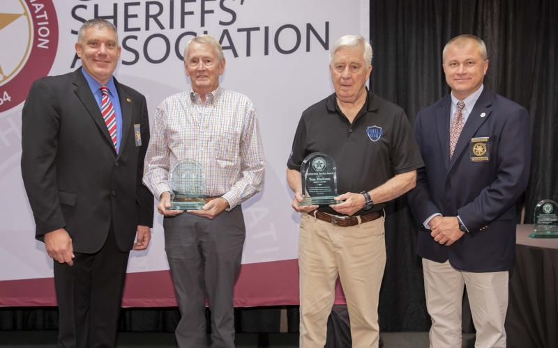Photo courtesy Rabun County Sheriff's Office. Rabun residents Stephen Wright and Tom Madison were presented with the Meritorious Award at the Georgia Sheriffs' Association Summer Conference at Lake Lanier recently. Above, from left: Rabun County Sheriff Chad Nichols, left, Stephen Wright, Tom Madison, and Georgia Sheriffs' Association President and Lumpkin County Sheriff Stacy Jarrard.