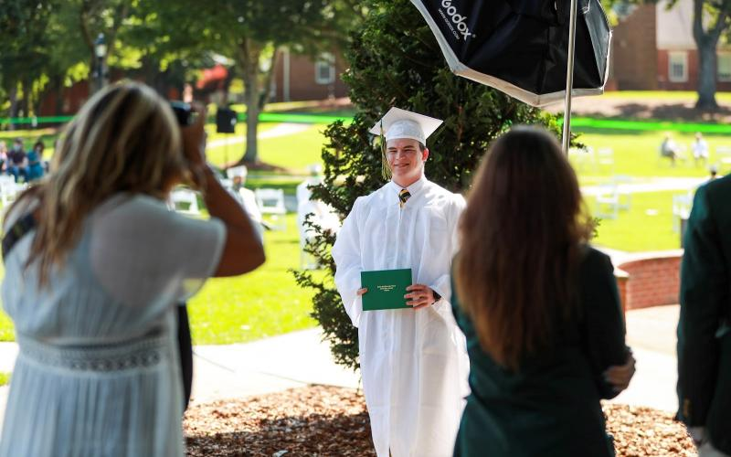 Rabun Gap-Nacoochee School senior Quillen Martin '20 of Clayton, GA poses for some socially-distanced pictures after graduation.