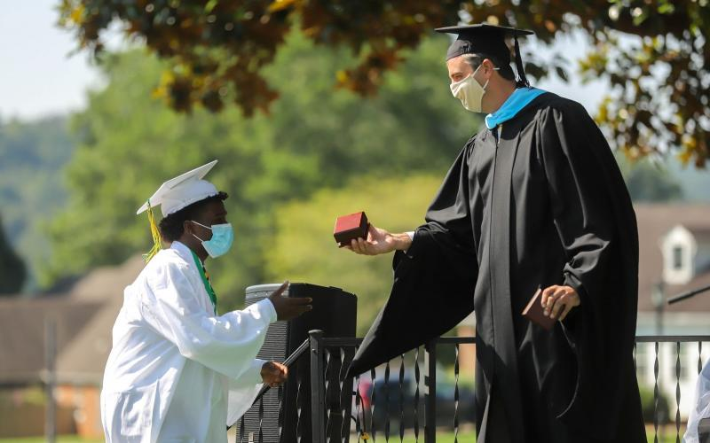 John Bonney '20 of Brooklyn, NY receives The Crystal Eagle Award on Sunday, August 9 during Rabun Gap-Nacoochee School's commencement ceremony.
