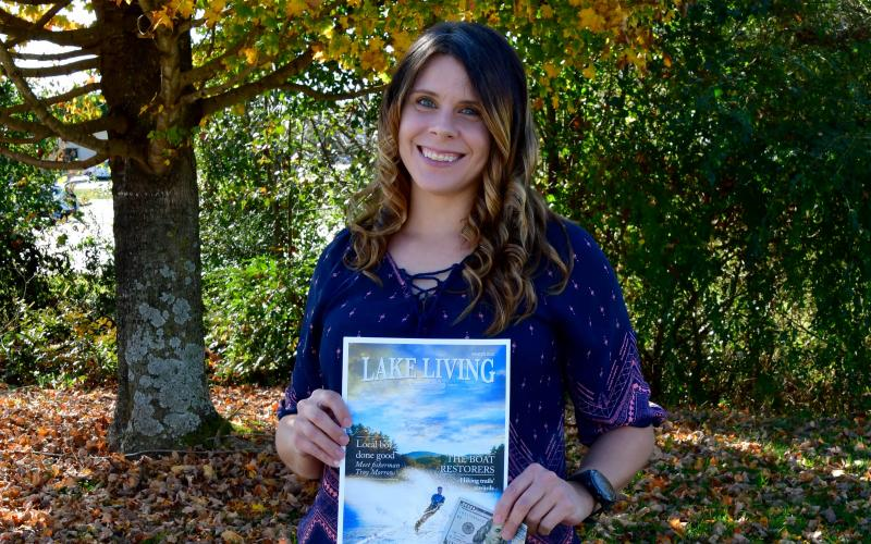 Photo courtesy Kimberly Brown. Heather Conner of Clayton holds a copy of her photograph of a water skier, which graces the cover of the winter 2020 edition of Lake Living magazine. In addition to having her photograph on the magazine's cover, Conner won $100.