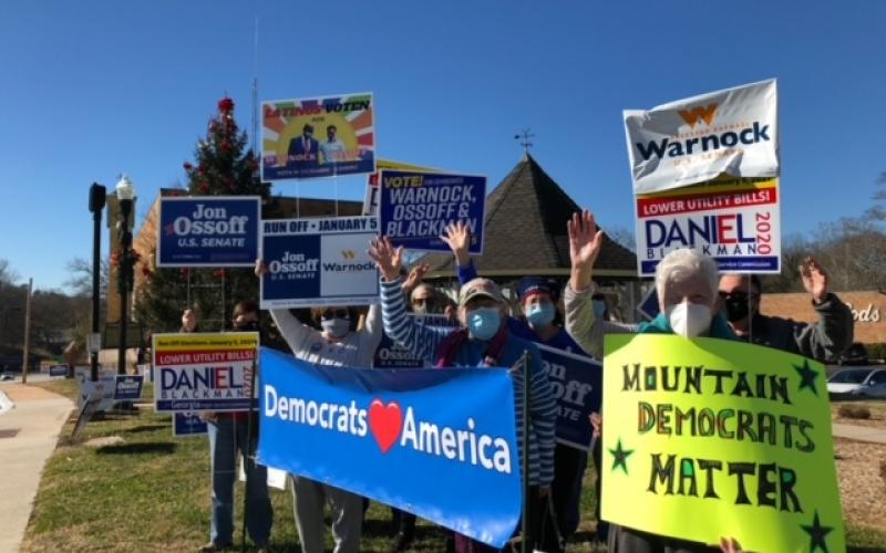 "Submitted photo. The Rabun County and Habersham County Democratic parties hold a ""flash mob"" campaign event. The Rabun County Democrats travelled to neighboring counties to give out free Warnock and Ossoff signs ahead of the Jan. 5 runoff."