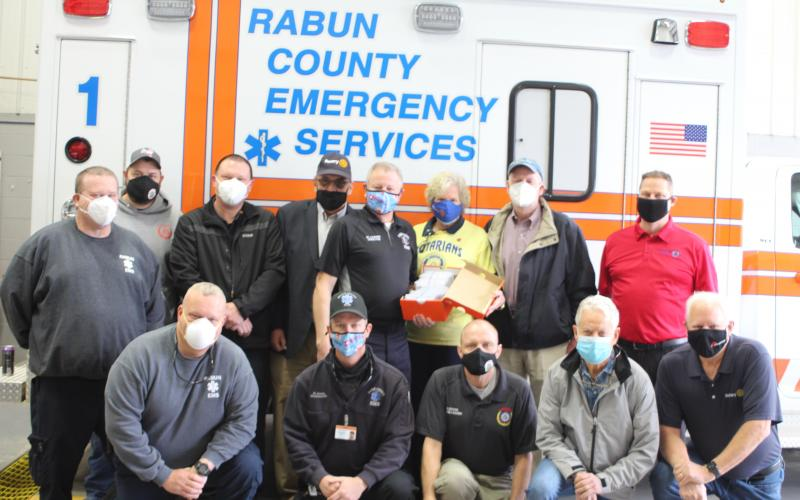 Megan Broome/The Clayton Tribune. David Lyle, paramedic, front left, David Jones, paramedic, Greg Dover, E-911, Ray Pagano, Rotarian, and Jef Fincher, Rotary president-elect.  Arne Triplett, back left, advanced EMT, Geoffrey Justus, E-911 supervisor, Captain Trampes Stancil, Wayne Knuckles, Rotary president, Mike Carnes, EMS/911 director, Jane Janes, Rotarian, Matt Mitcham, Rotary secretary, and Tony Penrose, Rotarian.