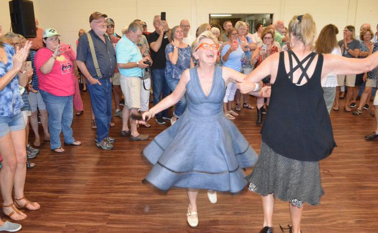 Wayne Knuckles/The Clayton Tribune. Cyndae Arrendale of Clarkesville twirls across the dance floor Saturday in Mountain City. The event was part of Rabun County's 200th birthday celebration.