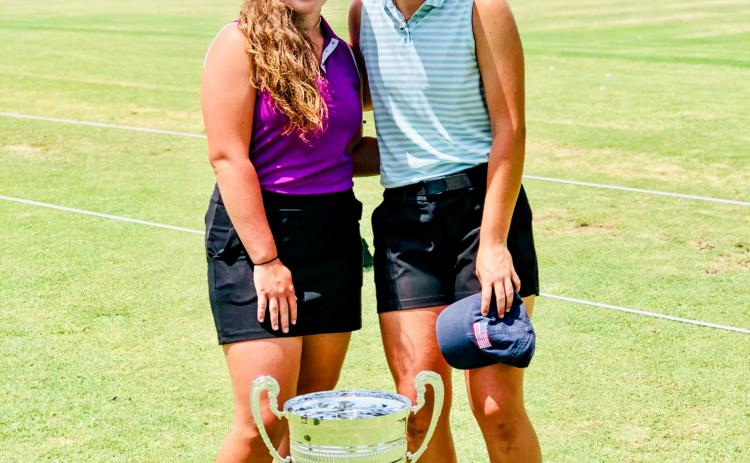 Juniors Brinson Hall of Mt. Airy, left, and Maggie Jackson of Clarkesville, varsity golfers from Tallulah Falls, spent a week at the  Fellowship of Christian Athletes Golf Camp held annually on St. Simons Island. (Submitted Photo)