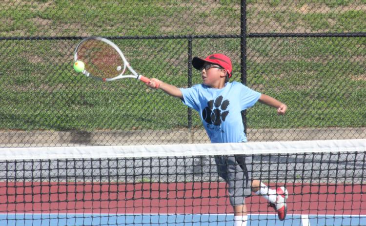 Jack Getty extends to return a ball during a singles match at Rabun County High School's tennis courts in Tiger on Tuesday. (Photo by Glendon Poe/The Clayton Tribune)