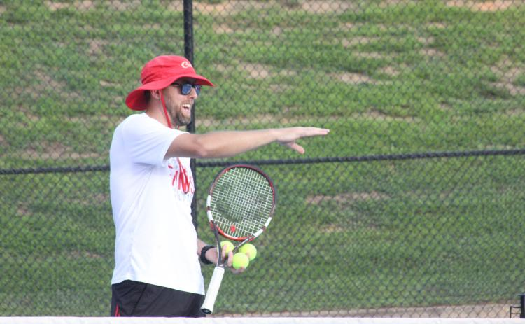 Rabun County tennis coach Bryan Getty instructs players during the Wildcat Tennis Academy at Rabun County High School's tennis courts Monday night. (Glendon Poe/The Clayton Tribune)