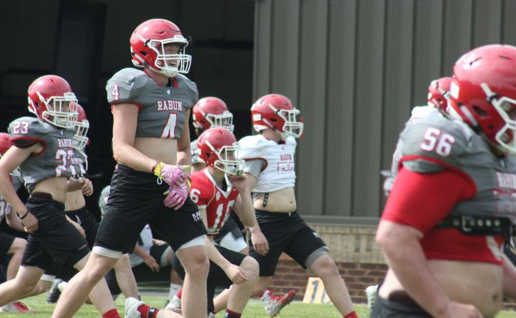 Rabun County wide receiver Braxton Hicks smiles during the team's warm-up session at a spring practice in May. (Glendon Poe/The Clayton Tribune)