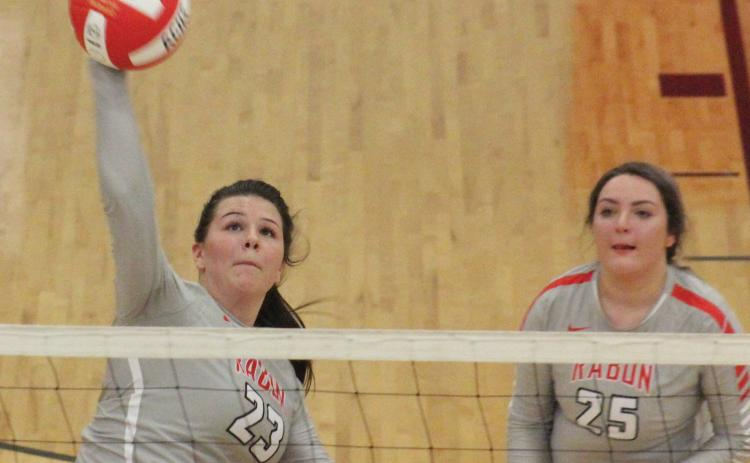 Destiny Deetz (23) attempts a kill while teammate Lyndee Hollifield (25) looks on during a match against Prince Avenue Christian at Ken Byrd Court in Tiger on Tuesday night. (Glendon Poe/The Clayton Tribune)
