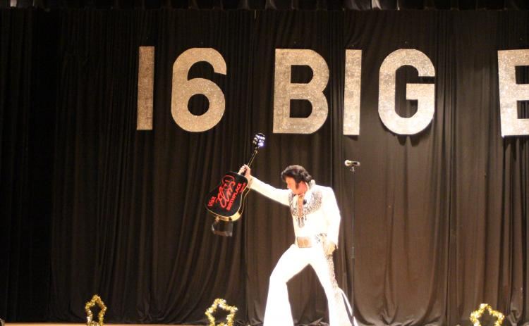 Megan Broome/The Clayton Tribune. World Champion Elvis Tribute Artist David Lee entertains a crowd of Elvis fans who attended a concert on the weekend of the 2019 Big E Festival and Elvis Tribute Artists Competition by singing, dancing and showing off his guitar.