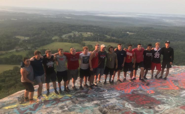 Rabun County senior football players are pictured with coach Jaybo Shaw at Currahee Mountain. (Submitted Photo)