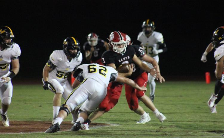 North Murray defensive lineman Hayden Jones (62) attempts to tackle Rabun County linebacker AJ Wheeler (3) after an interception during the second half at Frank Snyder Memorial Stadium in Tiger on Aug. 30. (Glendon Poe/The Clayton Tribune)