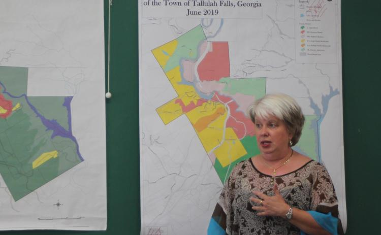 Tallulah Falls Mayor Teri Dobbs looks over a zoning map of the town at a joint work session of the City Council, Downtown Development Authority and Planning Commission last Thursday. City officials plan to add updates to the 1999 zoning map.