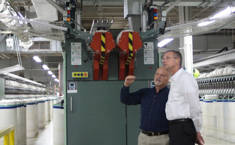 Weldon Wahl, plant manager for the Parkdale Rabun Gap facility, takes Rep. Doug Collins, who represents Georgia's 9th congressional district, on a tour of the Parkdale textile plant in Rabun County last Thursday. Wahl showed Collins the automated machinery inside the facility and introduced him to some of Parkdale's employees. Parkdale is one of the largest providers of spun yarns in the world.