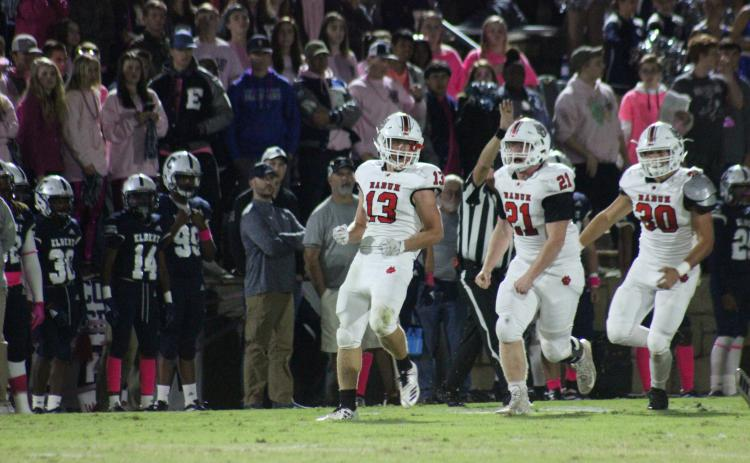Rabun County linebacker Brody Jarrard (13), defensive lineman Phillip Roberson (21) and linebacker Hoff Windham celebrate after Jarrard's tackle for a loss during the first half against Elbert County at the Granite Bowl in Elberton last Friday night. (Glendon Poe/The Clayton Tribune)