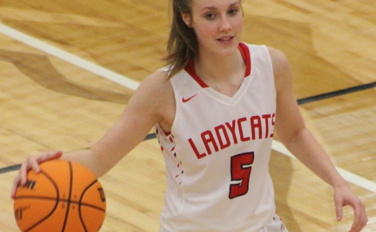 (Andy Diffenderfer/The Clayton Tribune) Loren Stiles canned two threes Tuesday and scored eight points in the Ladycats' Region 8-AA win over Elbert County.