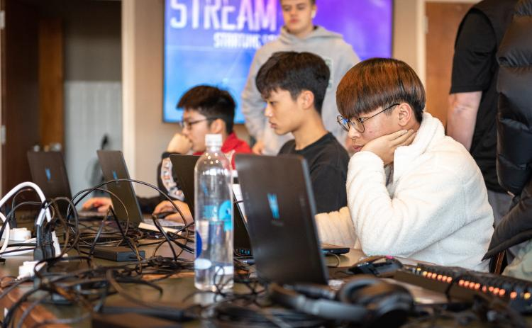 E. Lane Gresham/Tallulah Falls School. Shown in the foreground is Tallulah Falls School junior Justin Yu of South Korea during the Jan. 21 Esports Elite Eight match versus Lambert High School. Also shown, front to back, are team members Daniel Shin of South Korea and Janson Zhou of the People's Republic of China, both freshman.