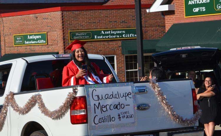 Wayne Knuckles/The Clayton Tribune. Members of the Class of 2020 were honored with a parade through Clayton Tuesday. Guadalupe Mercado-Castillo is all smiles as the crowd applauds.