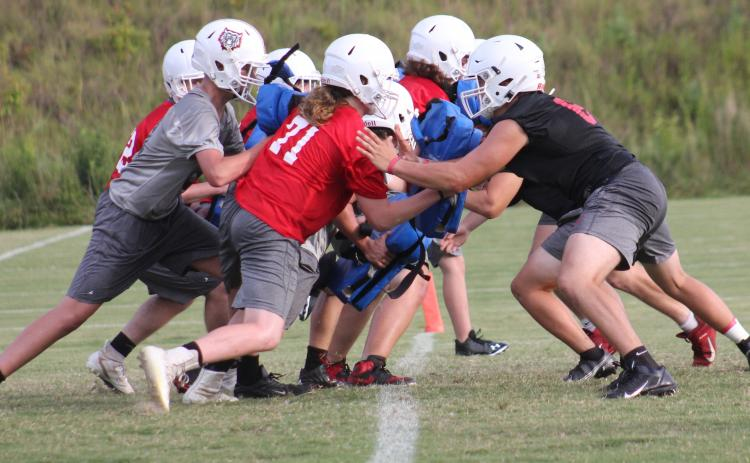 Andy Diffenderfer/The Clayton Tribune. The Rabun County Wildcat gridders opened practice Monday.