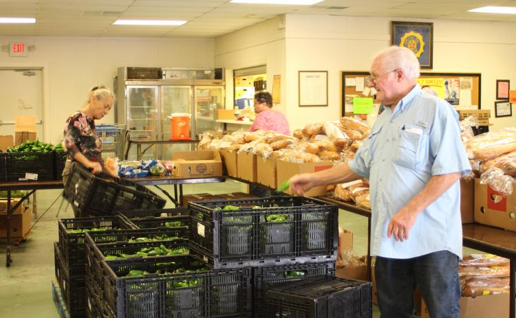 Megan Broome/The Clayton Tribune. Carl Green works to move boxes and organize food to be distributed to residents of the community at the American Legion Post 220 food distribution last Thursday.