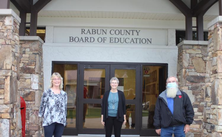 Megan Broome/The Clayton Tribune. Retirees of Rabun County Schools, Judy Burch, 14 years, Becky Cross, 25 years, and Pop Wilburn, 13 years, were recognized at the September Board of Education meeting.