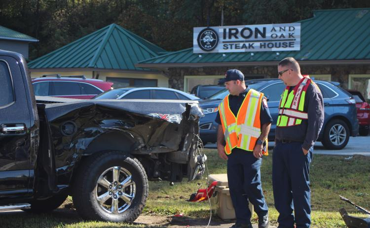 Megan Broome/The Clayton Tribune.Firefighter Hunter Hargrave, left,  and Assistant Fire Chief Justin Upchurch respond to the scene of a five-vehicle accident on Highway 441 at Bo James St. in Clayton on Monday.